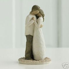 this reminds me of me and Kelly... if we were small wooden figures..