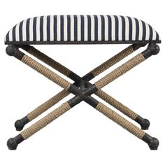 A nautical bench that features a rustic iron frame with a nautical touch, wrapped in natural fiber rope accents.  Dimensions: 24 W X 16 H X 20 D