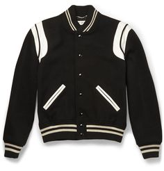 Saint Laurent's designer Mr Hedi Slimane has a knack for reinventing wardrobe staples. This varsity jacket has been crafted in a monochrome palette, with a wool-blend body and supple leather trims, creating a contrast of colour and texture that's hard to beat. Keep your look lean and sharp for a city-cool take on a retro style.