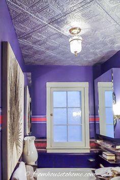 Purple bathroom with styrofoam faux tin ceiling tiles painted silver Faux Tin Ceiling Tiles, Tin Tiles, Covering Popcorn Ceiling, Light Fixture Covers, Ceiling Installation, Ceiling Design, Ceiling Ideas, Ceiling Decor, White Ceiling
