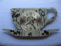 Wooden teacup shaped clock