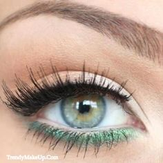 Sea green eyeliner for a pop of color.