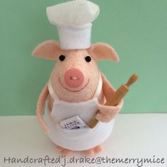 Piggy in chef hat and apron ready to bake.
