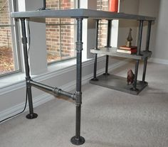 Add some industrial strength to your office space with this custom made pipe desk. This desk features 2 shelves and is 50 long by 22 deep by 30 tall. It is made of all new materials. The pipes are raw black steel and then coated with a protective finish. The pipe can be painted to