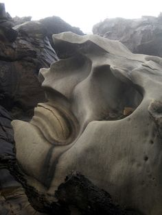 Natural sculpture rock erosion from the elements causes the creation of this amazing sculpture like land art in the form of a great stone god, or rock spirit emerging from the landscape