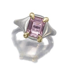 Topaz ring by JAR, with a step cut pink topaz set in a brushed platinum mount with yellow gold claws, signed.