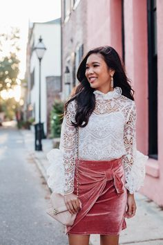 Lace crochet blouse and pink velvet skirt with Chanel bag