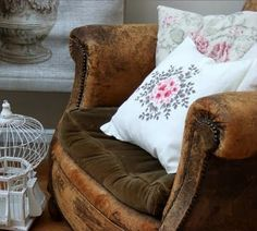 Velvet & leather - pretty. This old leather chair still looks fantastic because the style is classic.