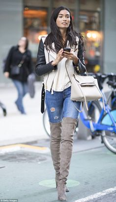 Golden gal!The dark-haired beauty added to her neutral toned ensemble by toting a beige handbag with gold accents that matched her jacket's zippers