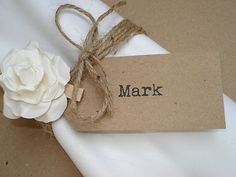 Name cards with a rose and twine for senior send off... Put alumnae chapter info on back