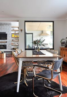 Sophie's Modern Vintage Mix in Western Australia | Love the brass framed dining chairs and end chairs as well as the fabric (black dots on white for the side chairs and velvety charcoal for the end chairs).