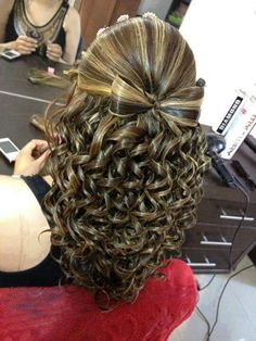 Curled hair in a bow, wedding hairstyle idea