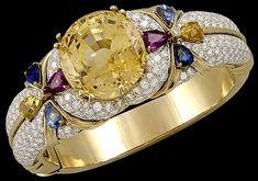 18kt. Yellow Gold Diamond, Ruby, Sapphire & Natural no heat 79.28 ct. Yellow Sapphire Bangle.