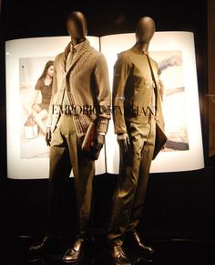 Love the huge images behind the models, creating a life-size book! ---> Emporio Armani windows 2013, Paris