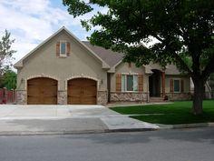Brown Garage Door, Wooden Garage Doors, Wooden Shutters, Window Shutters, Stucco Homes, Stucco Exterior, Exterior Design, Exterior Paint, Garage Door Styles