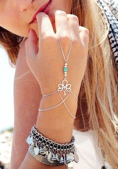 Add a boho vibe to any outfit by wearing this silver turquoise-beaded slave…