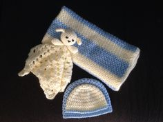 Crochet newborn set, blanket, lamb lovie and hats. This was a fun project!  For the blanket I followed this pattern and just added stripes: http://www.ravelry.com/patterns/library/fast-easy-crochet-baby-blanket    For the lamb lovie I followed youtube instructional video: https://m.youtube.com/watch?v=Wn_8UagKXc8 and made my own ears to make a lamb.    For the hats I followed the pattern on http://www.oombawkadesigncrochet.com/2014/04/simple-double-crochet-hat.html
