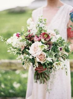 Spring garden style bouquet of hellebores and roses