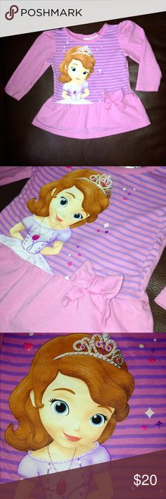 Sofia the First 👑👸100% Cotton Sparkly Peplum Top Sofia the First 👑👸 100% Cotton Sparkly Peplum Top • Features Princess Sofia on the front with sparkles on her Crown & her Jewelry • a bow on the side of the shirt with a ruffle peplum bottom • Pink & Purple striped body with Pink sleeves ✨ EXCELLENT CONDITION! ✨ Disney Shirts & Tops Tees - Long Sleeve