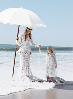 A parasol provides shade on a sunny day for the lace-clad Caroline Trentini. Photographed by Patrick Demarchelier, Vogue, November 2011.