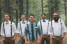Button up dress shirts, bow ties, suspenders, and khaki chinos for the groomsmen. The groom is dressed in a different colored dress shirt and a long, skinny tie.