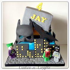 Tilting batman with edible lego batman figures - 2 tier tilting batman cake with gum paste mask and batarang and edible Lego batman characters- batman, robin, joker and 2 face