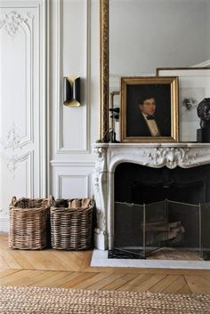 fireplace with oil portrait and large baskets holding firewood - french apartment Interior Design Minimalist, Salon Interior Design, Home Interior, French Interior Design, Contemporary Interior, Luxury Interior, Antique Interior, Interior Stylist, Design Living Room