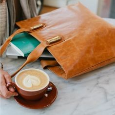 Caramel Leather Tote is Made from high-quality leather in Africa, this spacious bag can be updated with whatever Accent suits your mood. One bag, endless possibilities! #ssekostyle!