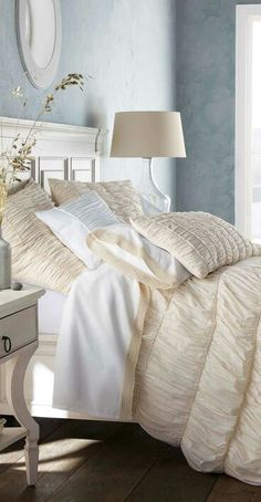 Tailored Bedroom in Creams and Ivories with washed out Blue Walls to give it Extra Interest !