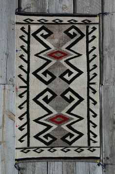 An example of a Crystal style rug. (J.B. Moore ran Crystal post from 1897-1911.  Moore was the first trader to create a mail-order catalogue of Navajo rugs.  Persian influence in the rugs' style.)