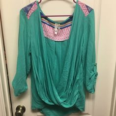 Bohemian Top Gorgeous teal green flowy top. 3/4 sleeves with a button clasp. Tribal details at shoulders and back. It is open from the front and requires a cami. Great with shorts and wedges. Size L but will fit a medium nicely as well. Boutique purchase. Can be dressed up or casual. Pink Owl Tops Blouses