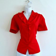 """$16 - Vintage 60s Ruffle Secretary Top - Size M - This beautiful secretary-style blouse from the late 60s or early 70s is a brilliant true scarlet red. The best detail is the ruffle collar! Little scarlet opalescent buttons and pleating details at sleeves and shoulder for a feminine and sexy shape. Lightweight fabric feels like polyester - has the slightest shimmery sheen. Bust - 37.5"""" Waist - 35"""" Length (shoulder to hem) - 23"""" Size - vintage 8, estimated M (PLEASE CHECK MEASUREMENTS)…"""
