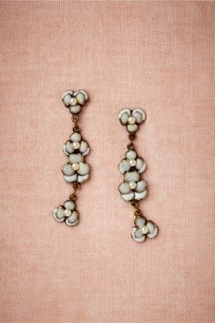 Heartsease Earrings from BHLDN: In a dainty stack of four, white pansies with pearl centers give your ensemble the prettiest touch of romance