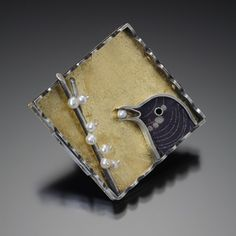 Sarah Wilbanks. Bird Eating Berries  Brooch in sterling silver, image transfer on polymer clay, gold leaf, and pearls.