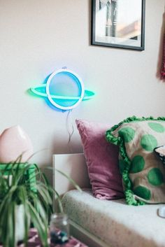 Saturn. Electric Confetti is the work of designer and illustrator Natalie Jarvis. Each sign is created using LED neon and is a piece of art. Available from Antipodream.