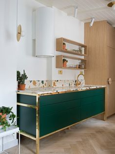 M&T: Love the gold/brass edging on the deep emerald unit and terrazzo style worktop with gold/brass tap. Can imagine a more industrial tap