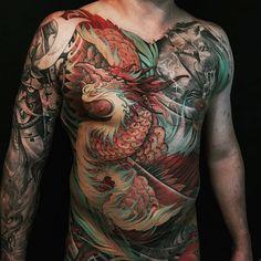 Chronic Ink Tattoo - Toronto Tattoo Close-up shot of the Phoenix tattoo done by Tristen.