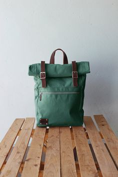 Green backpack with rolltop and waxed canvas