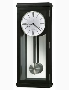 Howard Miller's Alvarez Wall Clock features a spun nickel-finished pendulum bob suspended on a black satin-finished wood stick in front of a mirrored back. This modern clock features a white dial with black hands and numerals. Chiming Wall Clocks, Howard Miller Wall Clock, Pendulum Wall Clock, Mantel Clocks, Modern Clock, Grandfather Clock, Transitional Style, Black Satin, Alarm Clock