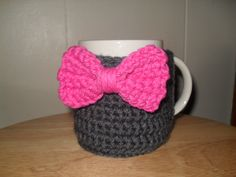 Crocheted bowtie mug cozy cup cozy in charcoal gray grey and hot pink.