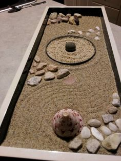 My mini Zen garden made with sand and objects personally found by me.