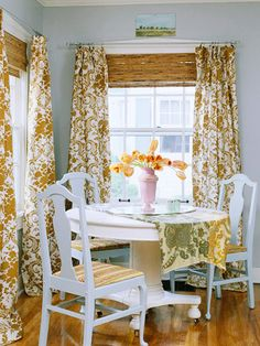 Casual Dining.This breakfast nook is all about color, texture, and pattern. Keeping with the rest of the home's flea-market feel, the homeowner chose to dress the windows in golden drapes with a vintage inspired pattern which pairs beautifully with the woven shades. Through the reupholstered chair cushions and makeshift table runner, the rich golden tones appear in a subtle manner.