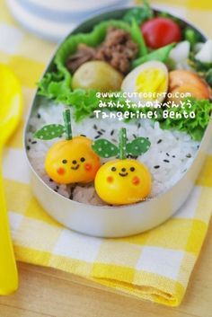 cuteobento.com. Tangerines were made by forming quail eggs into perfect circles by hand, then marinating in curry soup all day for color!
