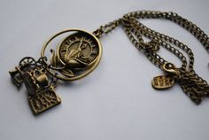 Once Upon A Time Rumbelle (Rumplestiltskin/Belle) Charm Necklace. £11.00, via Etsy.