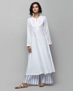 Tisya Plain Kurta from Women collection at Nicobar. Nicobar is for modern consumers who seek connection with things they acquire. Indian Attire, Indian Wear, Kurta Designs Women, Blouse Designs, Plain Kurti Designs, Kurta Patterns, Kurta Style, Tunics Online, Indian Designer Outfits