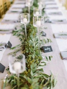 Calling all bookworms! Use stacks of books to create height and add impact to   small floral displays. Image: Dottie Photography