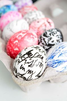 Eggs decorated with white-out pens, Q-tips, ballpoint pens and Sharpies via Alisa Burke