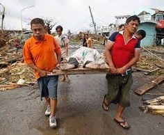 Cleaning up the deceased after the typhoon in the Philippines