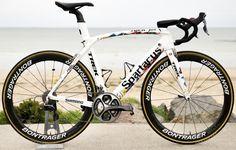 How much do Tour de France bikes weigh?  http://www.bicycling.com/racing/tour-de-france/14-questions-youve-always-had-about-the-tour-de-france/slide/13