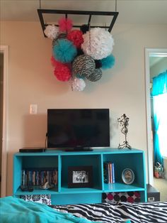DIY chandelier for Nevaeh's room.  Japanese lanterns with handmade paper and tulle poms. Teen girl bedroom ideas / teen